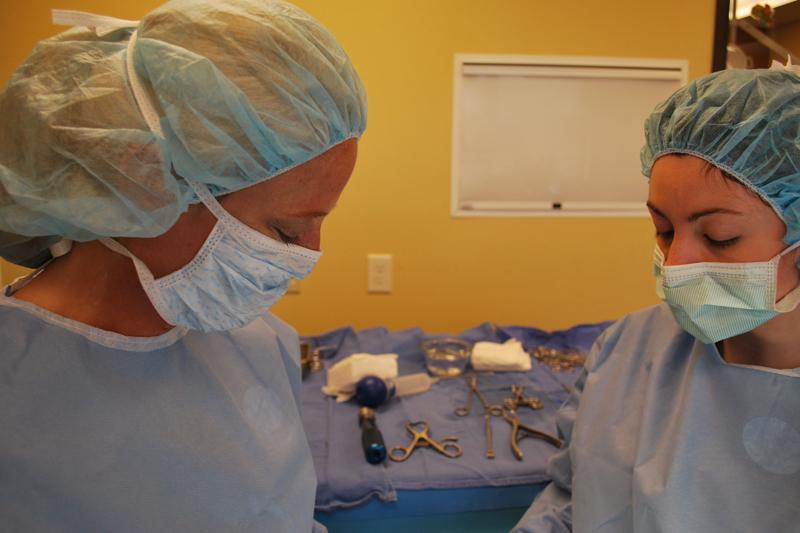 Drs. Wells and Carr in surgery
