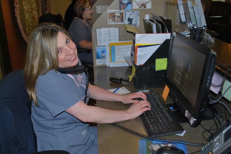 Lisa smiles as she multi tasks