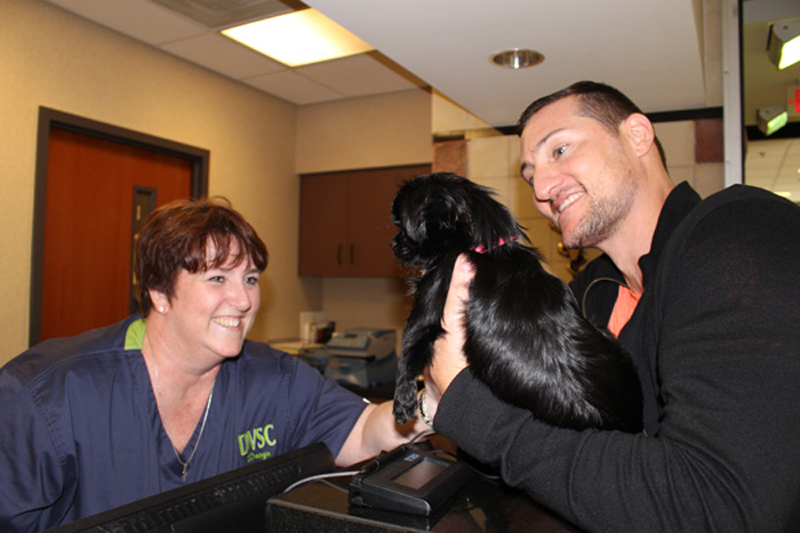 Daryn greets incoming patient and client