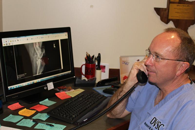 Dr. Radasch updates a client on their pet's status